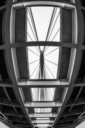 An amazing grayscale shot under two roads on a bridge