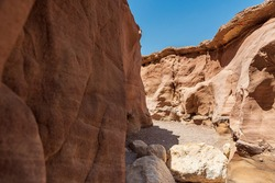 An amazing place in Israel is called the Red canyon and Nahal Shani, Southern District. Totally worth visiting because of its stunning stony structure. High quality photo