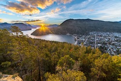 An amazing view of San Martin de los Andes town, the forest and Lacar lake in Patagonia. An amazing and inspirational road trip with awesome mountain views with huge lakes inside a extreme weather