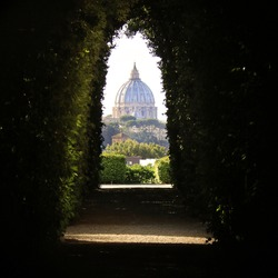 An amazing view of St. Peter's Dome through the Knights of Malta keyhole on the Aventine Hill in Rome.