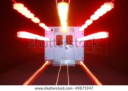 an ambulance speeds toward an emergency with its warning lights flashing
