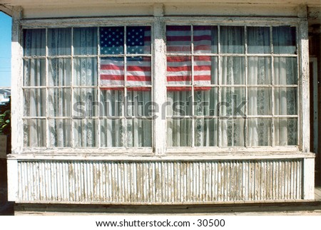 an american flag is proudly displayed in an old wooden window with old curtins showing that no matter how old you are you can still be proud to be an American!