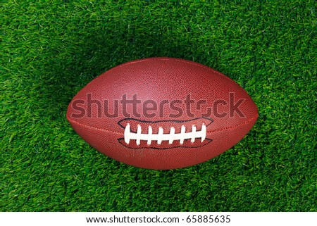 An American football on grass