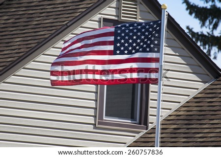 An American home displaying their flag.