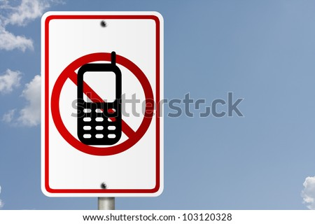 An American road sign with sky background and copy space for your message, No Cell Phones while driving
