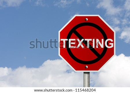 An American road sign with sky background and copy space for your message, Stop texting and driving