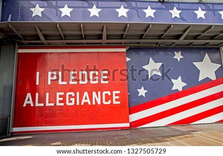 "An American sign, ""I Pledge Allegiance"" with stars and stripes in background. #1327505729"