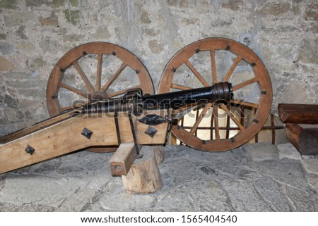 an ancient cannon in an ancient fortress
