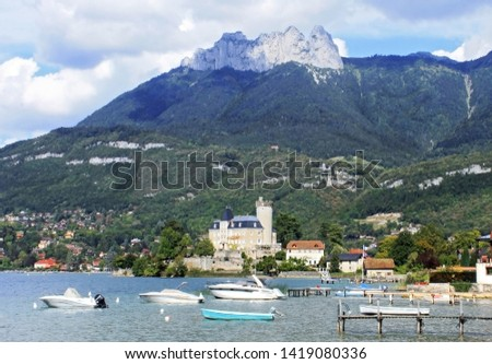 An ancient castle on the shore of Lake Annecy among the French Alps #1419080336