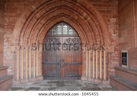 An Ancient Church Door Inside A Sandstone Arch With Heavy