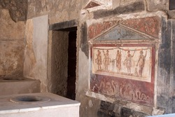 An Ancient Fresco on a Wall of a Roman Fast-Food restaurant in the Ruins of Pompeii