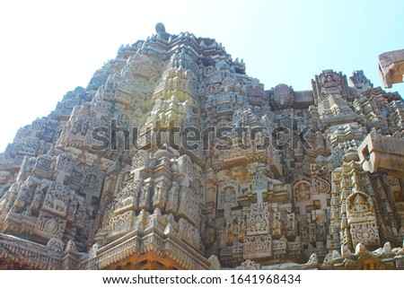 An ancient hindu temple in India. Carved complicated shapes elegantly using white stones.