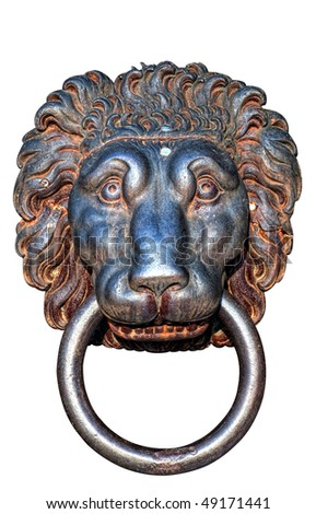 An ancient iron lions head door knocker isolated against a white background.