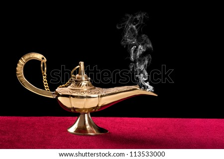 An ancient magic lamp on a red felt table top disperses a stream of mysterious smoke.