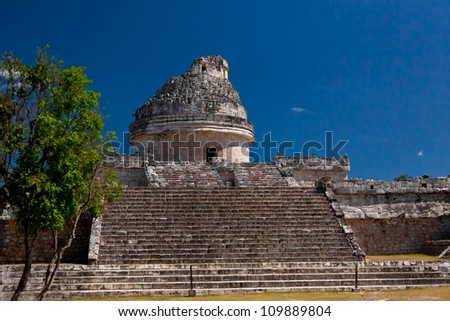 An ancient Mayan astronomical observatory located in the chichen itza arcaeological site, Mexico
