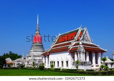 An ancient pagoda with a piece of sacred red cloth wrapped around at Phra Samut Chedi temple, a famous landmark in Samut Prakan Province, Thailand.