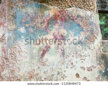 an ancient painting on wall of...