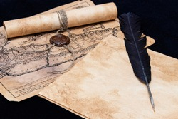 An ancient paper scroll sealed with a seal. Old map. Blank sheet of paper, pen for writing.