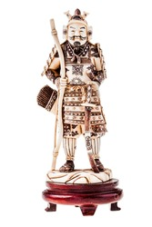 an ancient precious ivory japanese samurai warrior figurine isolated over a white background