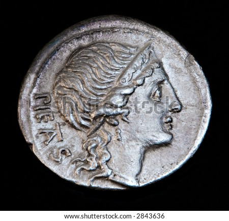 An Ancient Roman Coin With Pietas Head - stock photo