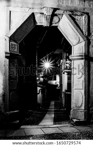 An ancient street of Overseas, Baveno (VB), Piedmont, Italy, Europe. Black and white photography.