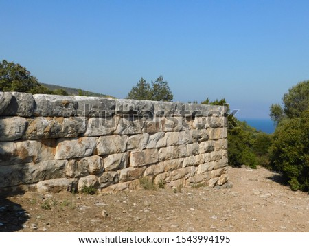 An ancient wall in the ancient city of Rhamnous, in Attica, Greece