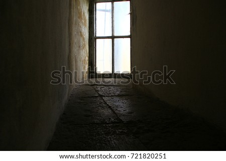 An ancient window at the end of a stone corridor #721820251