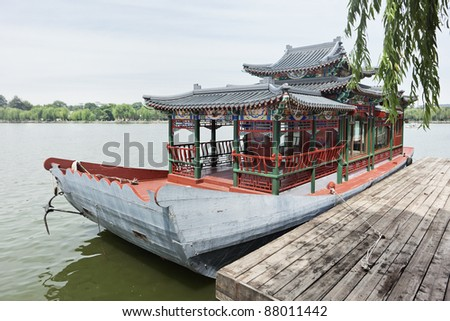 An ancient wooden vessel moored at Beihai Park, Beijing