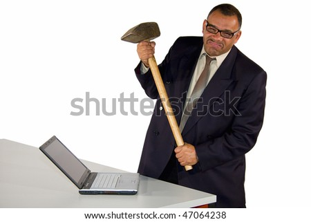 an angry and fierce looking mature African-American businessman aiming with a sledgehammer at his laptop, isolated on white background