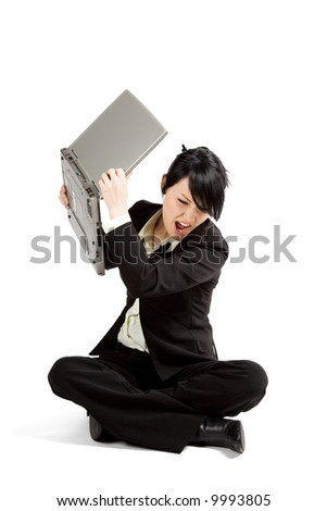 An angry and stressed businesswoman throwing away her laptop