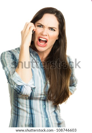 An angry and very frustrated business woman yelling on the phone. Isolated over white. - stock photo