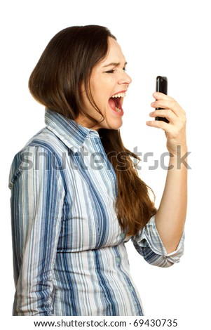 An angry and very frustrated young business woman yelling at her phone. Isolated over white.