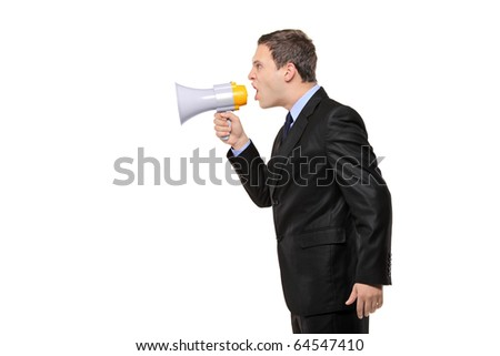 An angry businessman announcing via megaphone isolated against white background - stock photo