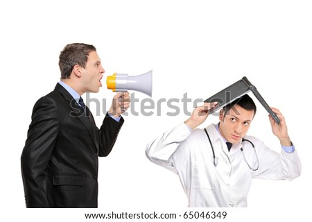 An angry businessman yelling via megaphone to a doctor isolated against white background