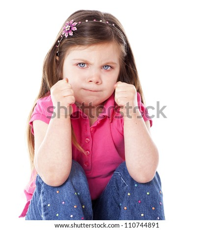 An angry child with fists clenched isolated on white
