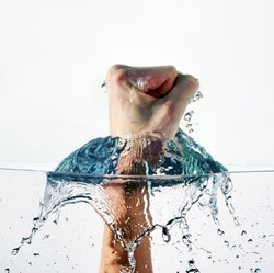 An angry fist punching water isolated on white background
