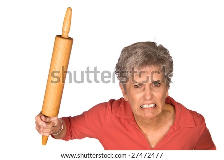 An angry grandmother is ready to swing her rolling pin to fend off unwanted bystranders.