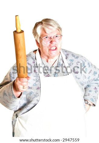 An angry grandmother shaking her rolling pin.  Flour all over her face.