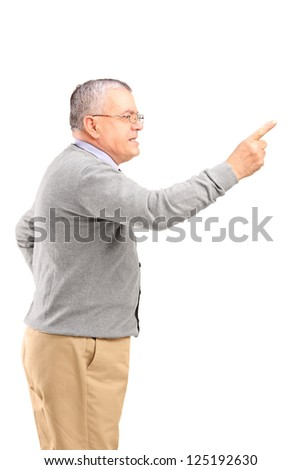 An angry mature man pointing with finger and threatening isolated on white background