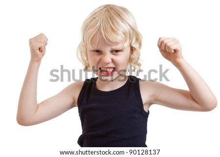 An angry mean looking boy flexing his muscles. Isolated over white.