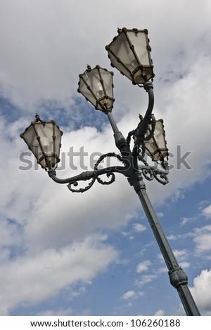 An angular shot of a light post in Austria