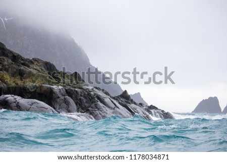Stock Photo an Antarctica landscape with ice bergs and the ocean iceland