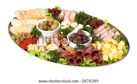 An antipasto catering platter of continental meats and feta cheese, plus marinated artichoke hearts, olives, sun dried tomatoes and marinated eggplant.