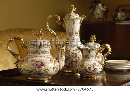 an antique china tea set on a table