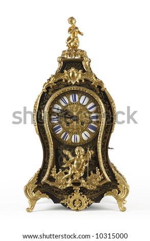 An antique clock ornate with golden Cupids and floral motives.