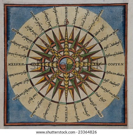 An antique compass rose from the 17th century - stock photo