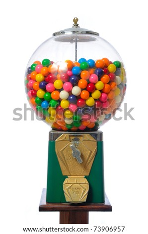 An antique gum ball machine isolated on white.