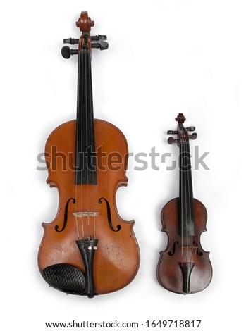 An antique Irish traditional dance masters fiddle, comparing its small size with a standard size violin.  Stock fotó ©