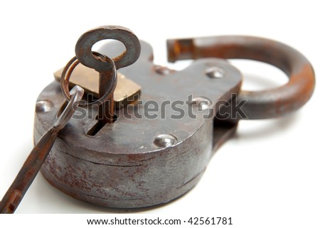 An antique lock with skeleton key on a white background - stock photo