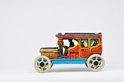 An antique Meier litho printed tinplate penny toy car on white background.